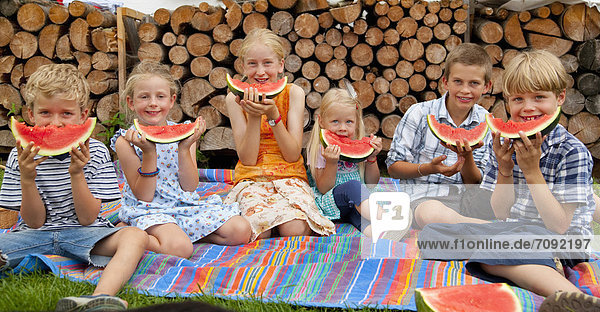 Germany  Bavaria  Group of children eating watermelon