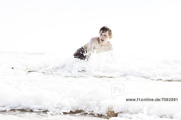 France  Boy surfing at Atlantic coast