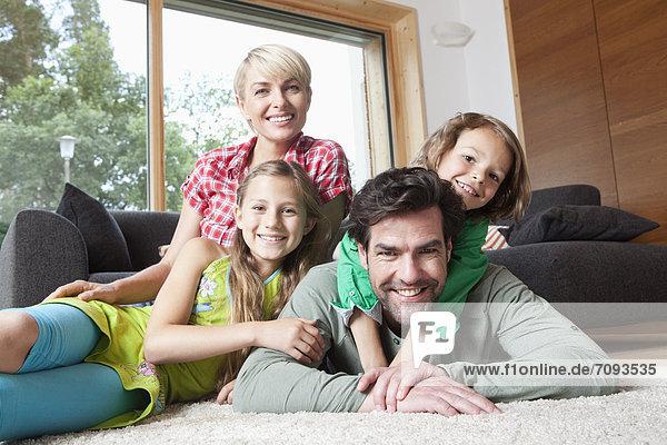Germany  Bavaria  Nuremberg  Portrait of family in living room