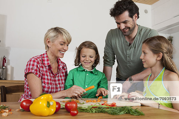 Germany  Bavaria  Nuremberg  Family cutting vegetables