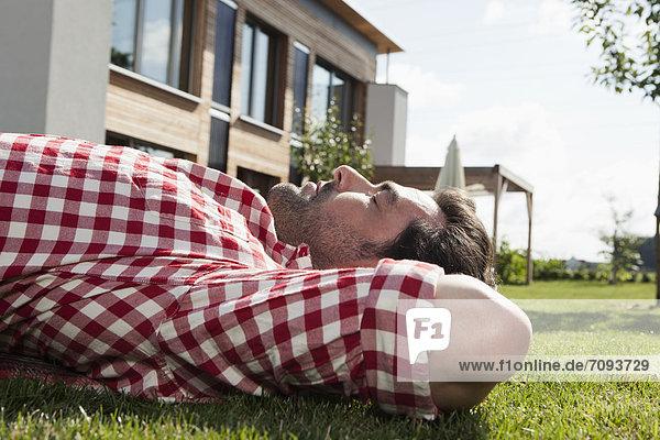 Mature man resting in garden