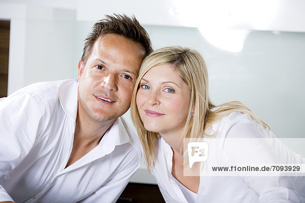 Germany  Mid adult couple standing in kitchen very close  portrait