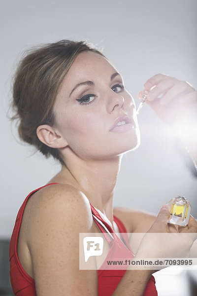Germany  Young woman smelling truffle oil