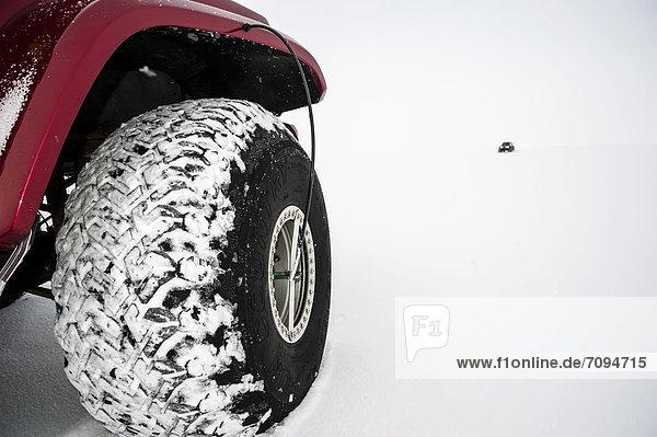 Balloon tyres  Super Jeep in a winter landscape  Vatnajoekull Glacier  Icelandic Highlands  Iceland  Europe