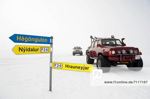 Snow-covered signpost  Super Jeep in a winter landscape  Vatnajoekull Glacier  Icelandic Highlands  Iceland  Europe
