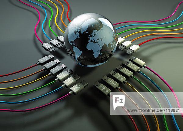Globus in der Mitte von bunten USB-Kabeln Globus in der Mitte von bunten USB-Kabeln