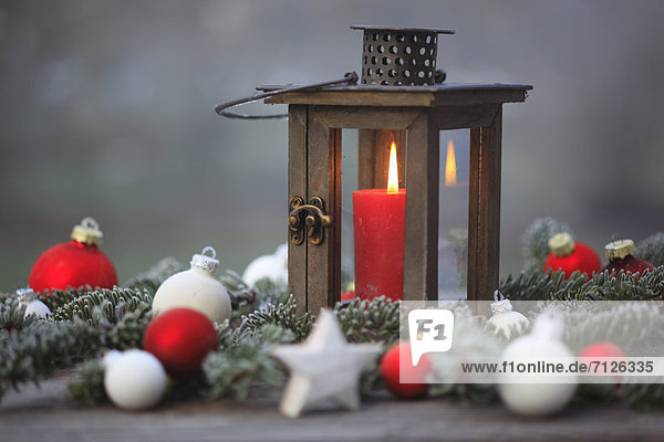 Advent,  deco,  decoration,  detail,  ice,  ice flower,  frost,  garden,  glass,  windowpane,  wood,  wood lantern,  wooden lantern,  candle,  candles,  candle light,  candle-light,  cold,  lantern,  light,  macro,  close-up,  window,  light,  sham,  star,  stars,  fir branch,  fir branches,  Christmas,  Christmas decoration,  Christmas ball,  Christmas balls,  yule tide,  winter,  warmth,  close up,  outdoors,  outside,  icy,  colorful,  frosty,  icy,  outside,  cold,  outdoor,  red,  warm,  white,  wintry