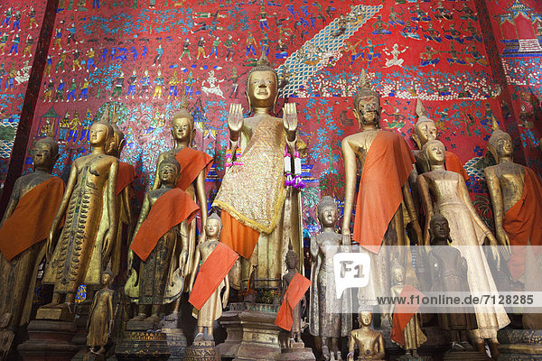 Asia  Laos  Luang Prabang  Wat Xieng Thong  Temple  Temples  Buddhist  Buddhism  religion  Buddhist Temple  Buddha Statues  Interior  UNESCO  UNESCO World Heritage Sites  Holiday  Vacation  Tourism  Travel