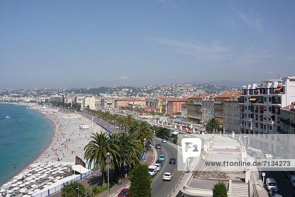 France  Europe  Nice  Nice  Côte d'Azur  beach  seashore  town  city  houses  homes  street promenade of the Anglais  palms