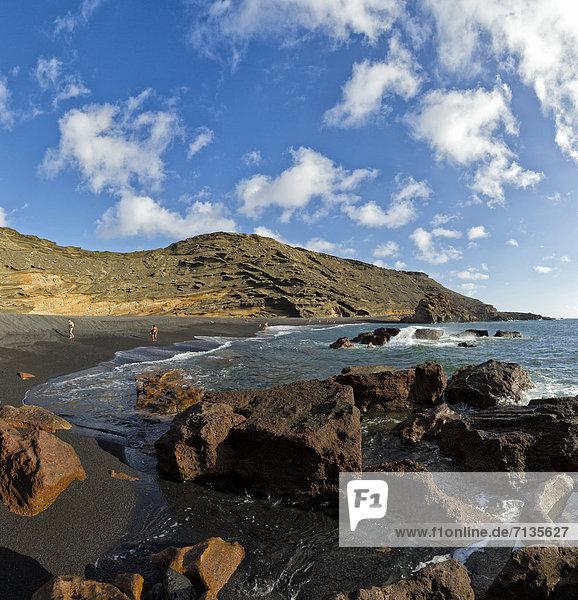 Spain  Lanzarote  El Golfo  Black lava-beach  landscape  water  summer  beach  sea  people  Canary Islands