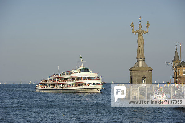 Ship entering the Lake Constance harbour entrance with the Imperia statue by sculptor Peter Lenk  Konstanz  Baden-Wuerttemberg  Germany  Europe