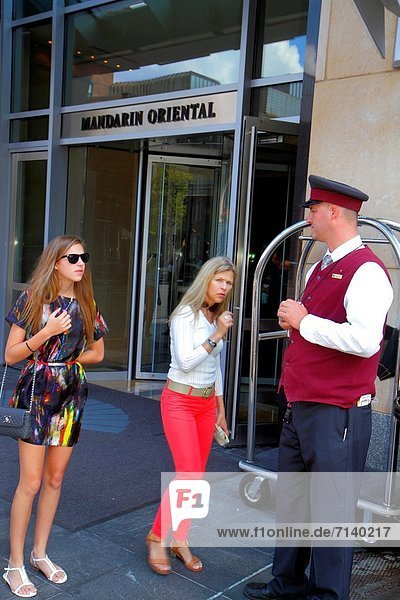 Massachusetts  Boston  Boylston Street  Mandarin Oriental Hotel  front  entrance  doorman  woman  teen  girl
