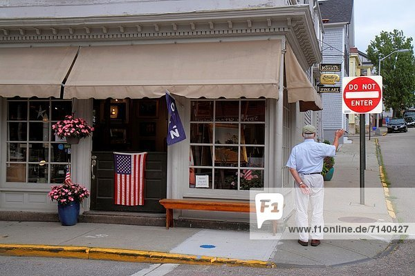 Rhode Island  Newport  Spring Street  business  senior  man  waving  small town  flag  Americana