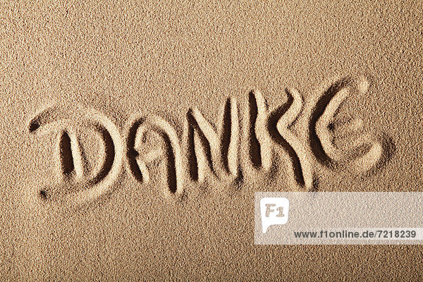 'Writing in the sand ''DANKE'' or ''THANKS'''