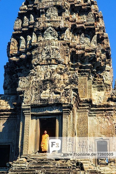 Monks outside of the World´s Largest Temple Angkor Wat Siem Reap Cambodia