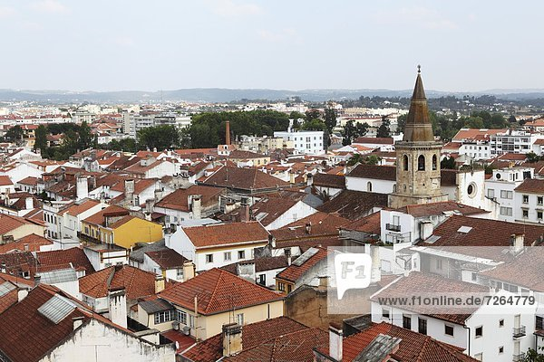 Roofs and the octagonal spire of the Church of St. John the Baptist (Sao Joao Baptista) in the city of Tomar  Ribatejo  Portugal  Europe