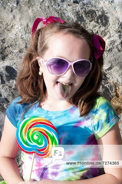 little girl sticking out tongue