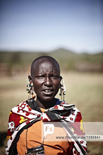 Maasai woman standing outdoors