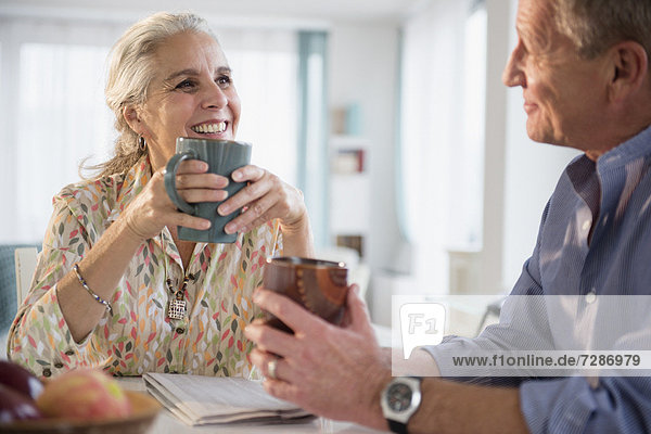 Elderly couple drinking coffee