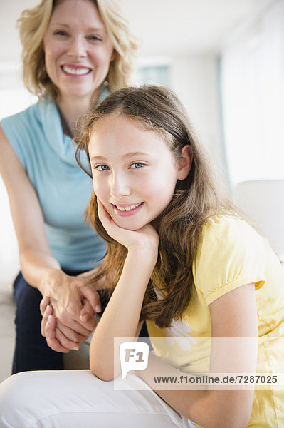 Portrait of mother and daughter (8-9 years)