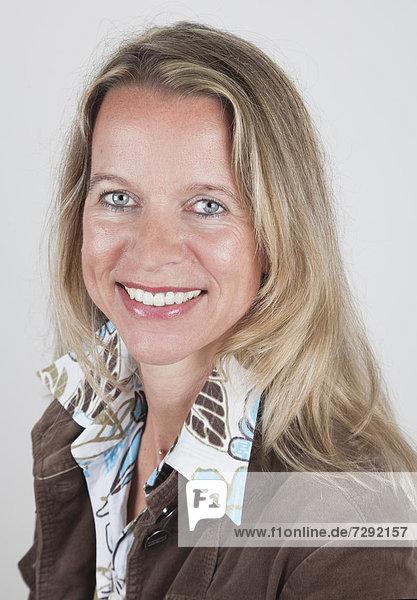 Mature woman smiling  portrait  close up