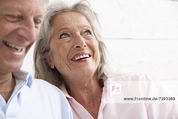 Spain  Senior couple in hotel  smiling