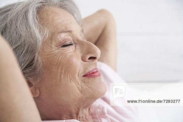 Spain  Senior woman relaxing  smiling