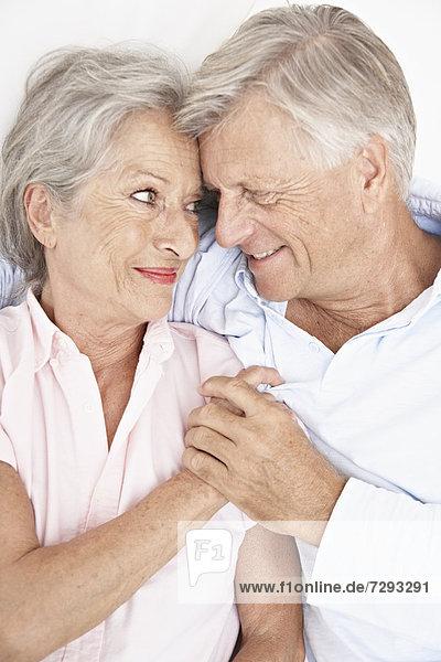 Spain  Senior couple relaxing in hotel  smiling