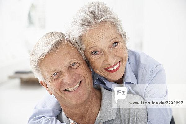 Spain  Senior couple in hotel  smiling  portrait