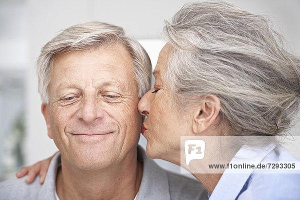 Spain  Senior woman kissing to man  close up