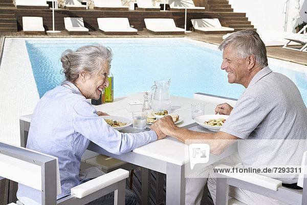 Spain  Senior couple having lunch at Mallorca