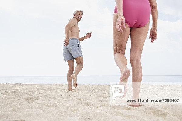 Spain  Mallorca  Senior couple walking on beach