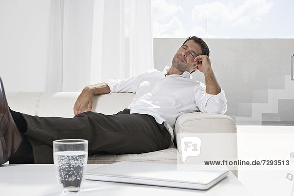 Spain  Businessman relaxing on couch