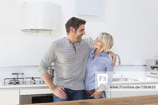 Germany  Bavaria  Munich  Mature couple in kitchen  smiling