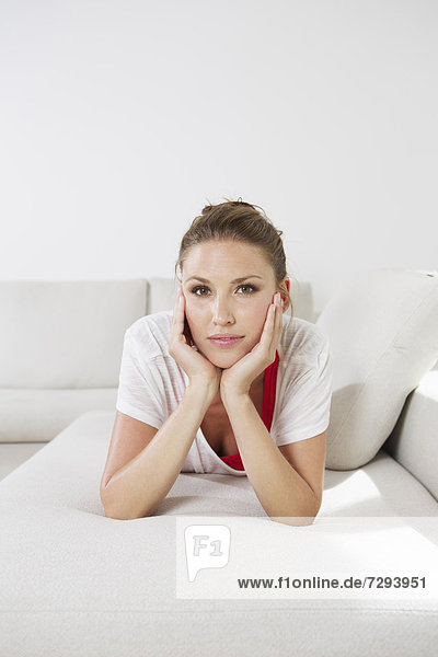 Young woman lying on couch  portrait