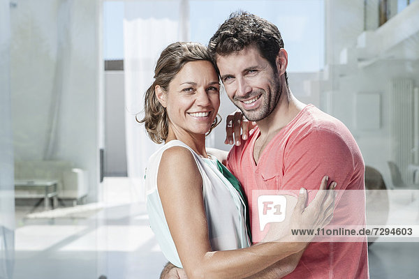 Spain  Mid adult couple embracing  smiling