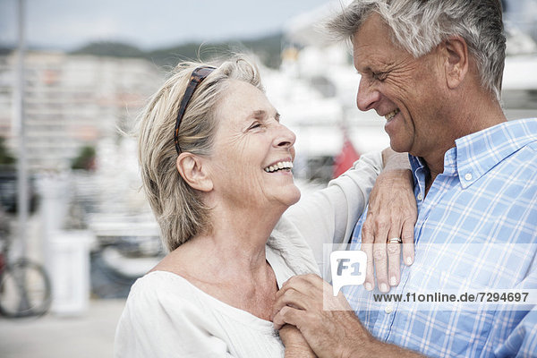 Spain  Senior couple at harbour