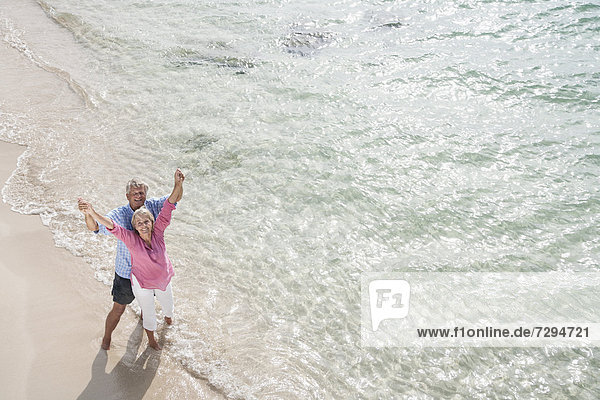 Spain  Senior couple standing on beach