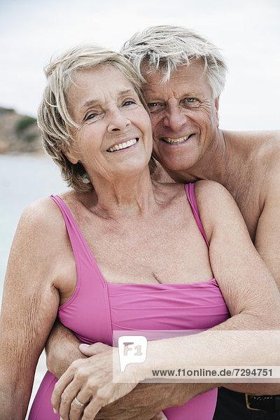 Spain  Senior couple embracing on beach