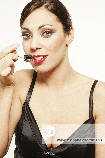 Woman enjoying caviar