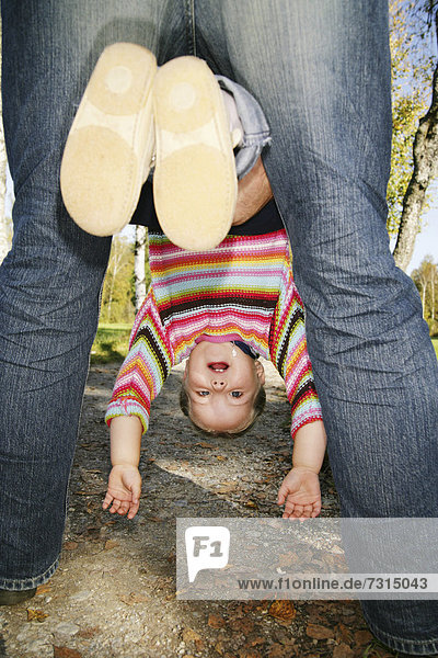 Father and his three-year-old daughter playing