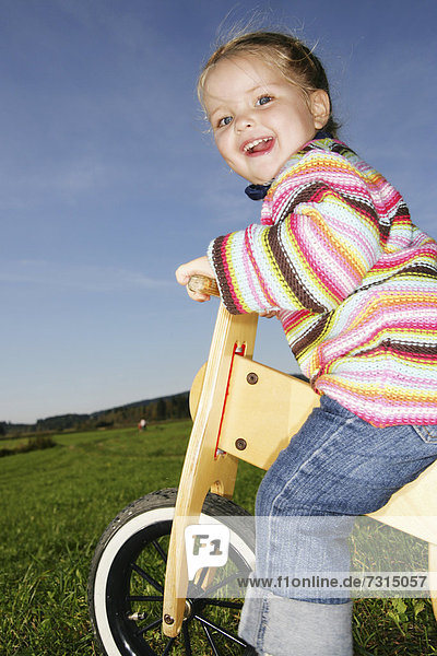 Three-year-old girl riding a bicycle