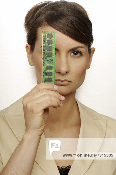 Portrait of a businesswoman  aged 24  holding a printed circuit board