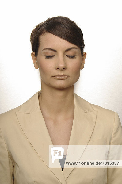 Portrait of a businesswoman  aged 24  with closed eyes