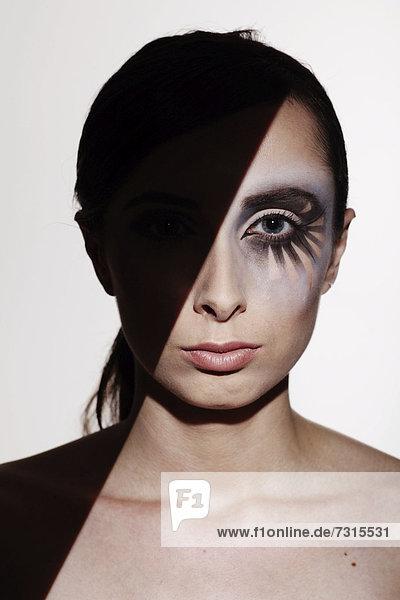 Woman  24  with striking eye makeup