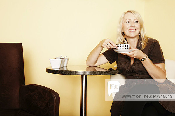 Woman  49  in a cafe
