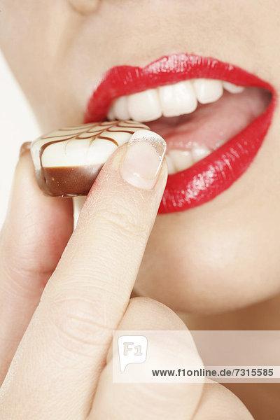 Woman sensually enjoying a chocolate mouth