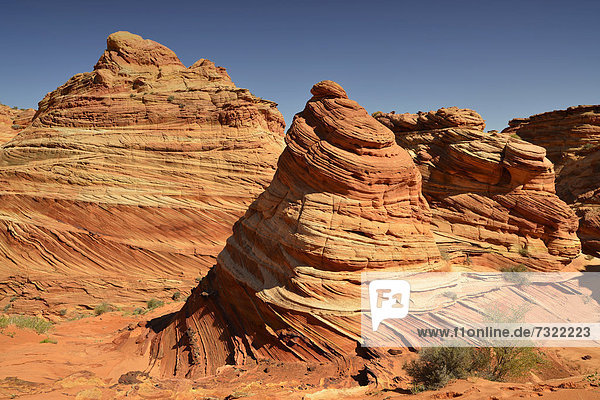 '''The Cove''  Brain Rocks of the Coyote Buttes South CBS  Cottonwood Teepees  eroded Navajo sandstone rock formations with Liesegang bands or Liesegang rings  Pareah Paria Plateau  Vermilion Cliffs National Monument  Arizona  Utah  Southwestern USA'