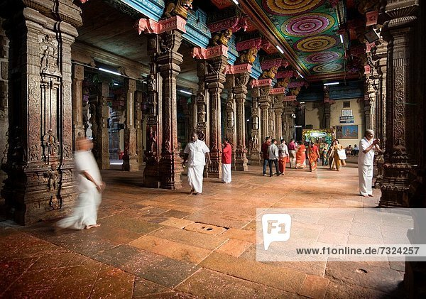 Madurai  India-September 11  2012 Many parishioners and pilgrims visit every year the Sri Meenakshi Hindu Temple where they pray and contemplate the architectural beauty
