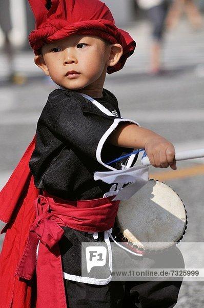 Naha  Okinawa  Japan  Taiko drums show along Kokusai-dori during the Naha Festival  October